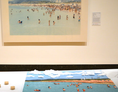 A photo of a beach scene and a tactile reproduction of the photo using sandpaper and cotton
