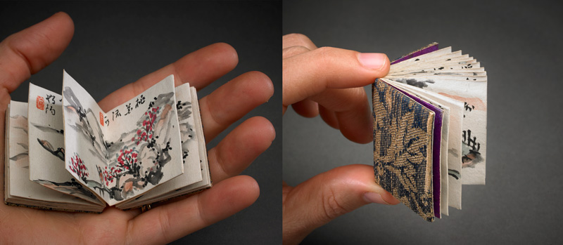 tiny books in a hand
