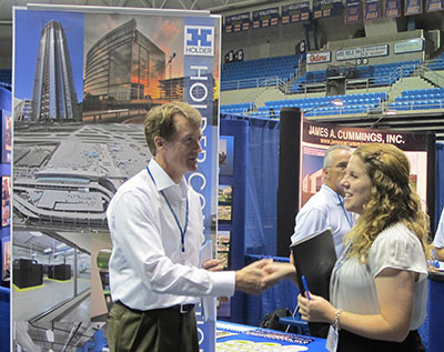 Holder vice president Wayne Wadsworth meets a student at UF's career fair.