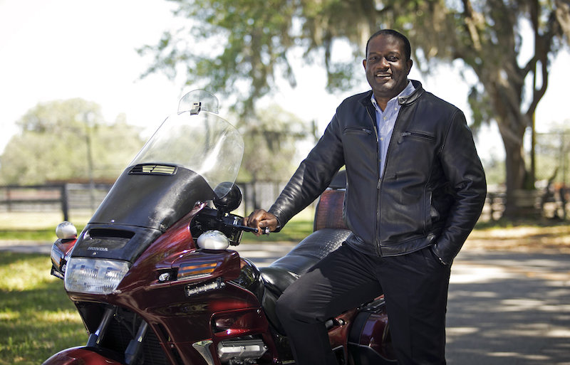 Gbola Adesogan with his motorcycle