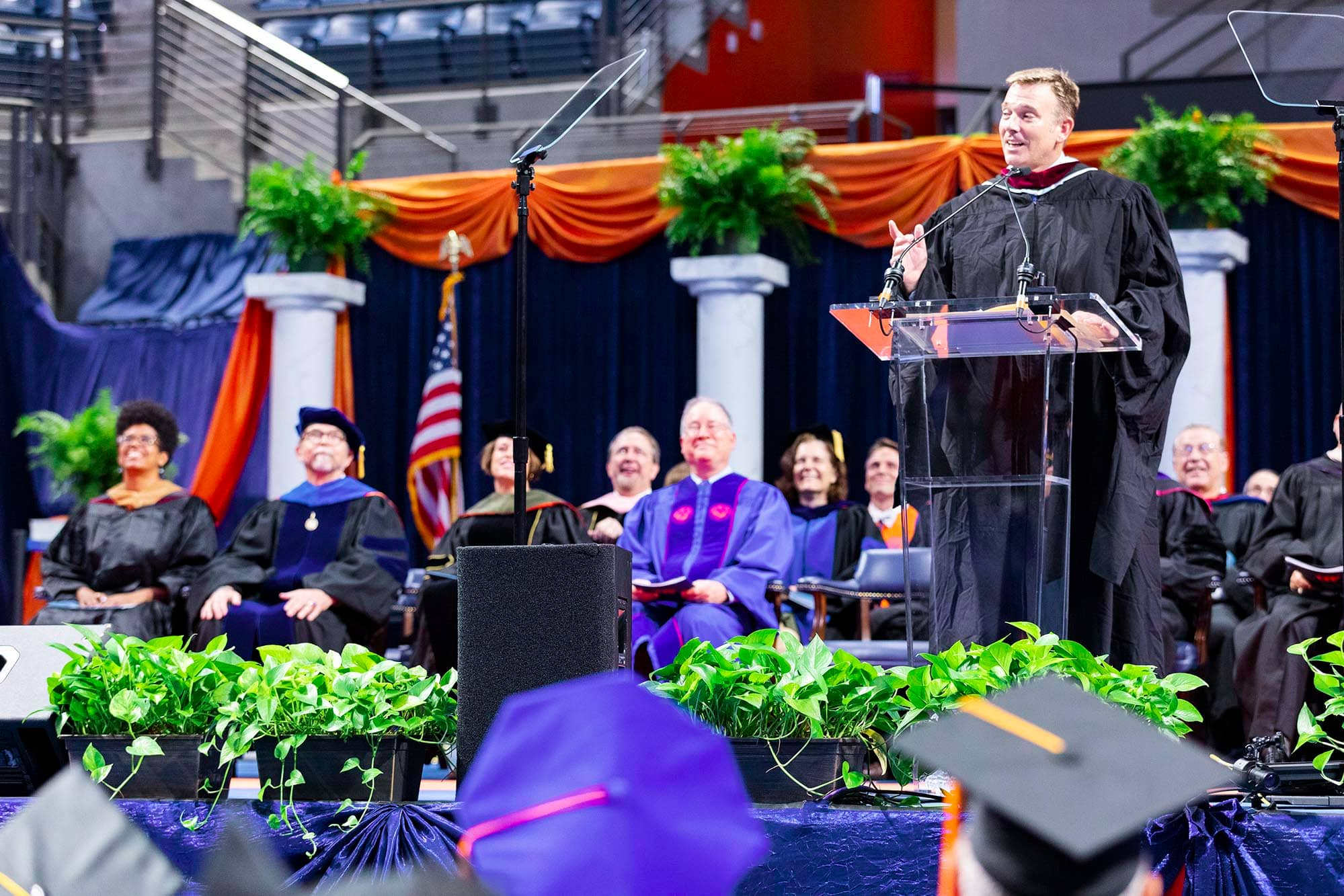 UF professor Ted Spiker addresses Friday's doctoral ceremony