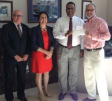 From left are: Rick Juday, partner in Efficiency Energy, LLC; Bahar Armaghani, 179D Program Leader; Curtis A. Reynolds, vice president for business affairs; and Scott E. Robinson, principal, AEI, Affiliated Engineers Inc.